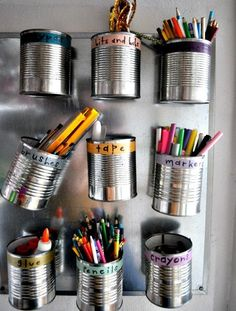 Reuse tin cans for fast and tidy art storage.