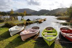 Colourful rowing boats on Grasmere in the Lake District