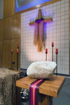 The rock, displayed on a pedastal with ribbons of purple and violet traditional during lent, can evoke feelings of heaviness, and lifelessness, hinting perhaps at the deep places of the earth and the stone that sealed the Lord's tomb. (Orchard Hill Reformed Church)