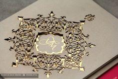 gold wedding invite with monogram