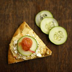 Delicious pita bread topped with roasted garlic hummus, feta cheese, fresh cucumber and sauteed onions in white wine. A hummus platter made the right way!