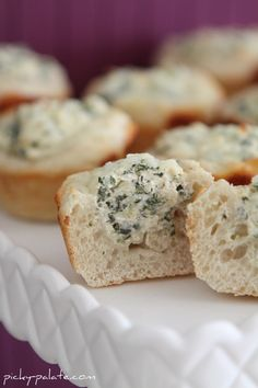 "Spinach Dip Bread Bowls: Pilsbury dough in cup cake tin, bake and fill with spinach dip! (this site has a recipe for the dip and bakes it all, but i would just buy some and put in ""bread cups"")"