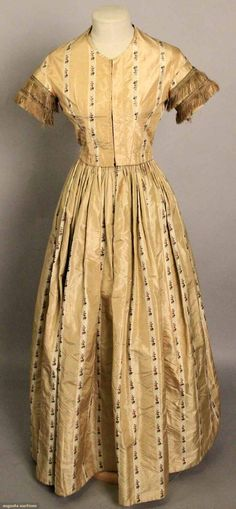 Silk brocade ballgown, c1852; Two-piece, pale gold, ivory vertical stripe with small magenta and green floral sprigs