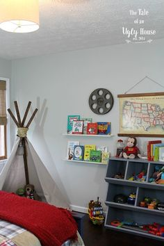 Love the teepee and toy corral in this little boy's room!
