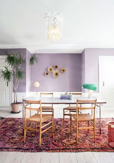 lavender walls in dining area with Boucherouite rug and vintage green snoopie lamp. / sfgirlbybay