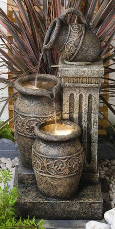 Greek Jug And Jars Water Feature With halogen Lights This realistic ancient Greek Style polyresin water feature complete with three cascading oil jars will look great both in and outside your home. This feature is fully self contained and comes with everything you need to get it working immediately - just add power and water.  No additional reservoir is required - the water recirculates from within a reservoir hidden inside the feature.