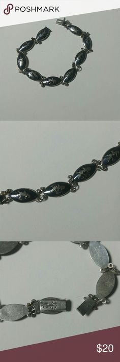 """Vintage Siam Sterling Niello bracelet A vintage marked """"Siam Sterling"""" 8.00"""" bracelet. Features a hidden safety clasp, and nine links of Makkala dancing. The last link needs new 'O' ring connectors, as there are temporary ones presently there. I've worn it like that without notice for some time. Jewelry Bracelets"""