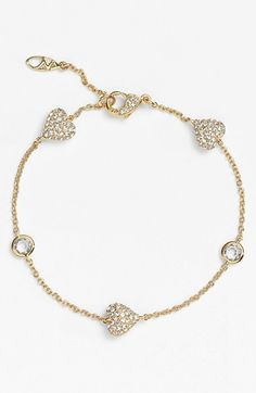 Mesmerized by this sparkly crystal and gold heart bracelet.