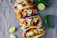 You guys. These Kung Pao Shrimp Tacos w/ Jalapeño Sauce! Spicy, savory, creamy, crazy. This asian-mexican fusion is DELISH and perfect for a quick and easy weeknight dinner!