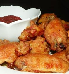 This is a very tasty way to make wings. You can dip them in your favorite sauce when baked or they are yummy as-is. Recipe from CD Kitchen on the Internet.
