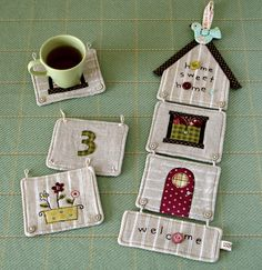 Very cute idea to connect quilted blocks: buttons and loops.  Technique has lots of possibilities.