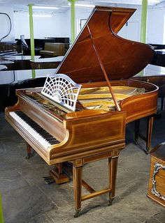 Bechstein model B grand Piano for sale with an inlaid, mahogany case.(1884)