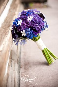 My bouquet with white peonies or roses rather than stephanotis. love the delphinium and hydrangea colors