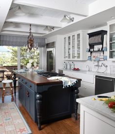 Beach or Country home with coffered beadboard ceiling.  Blue island, wood floors, butcher block countertop. Yes!