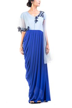 Featuring a floral embroidered  midnight blue dress with bell sleeves. Intricate embroidery has been done on the yoke and the sleeves using sequins, beads and thread.