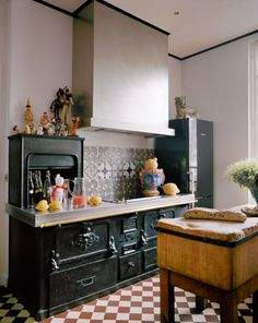Giambattista Valli's Paris Apartment Old stove and modern hood: