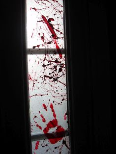 Halloween. Paint wax paper with red paint then tape over windows...CREEPY!