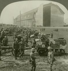 American soldiers of the 89th Infantry Division pose with their tractor-drawn artillery in front of the largest Zeppelin hangar in Germany during the Occupation of the Rhineland, 1918. chubachus:http://digitalcollections.smu.edu/cdm/ref/collection/bml/id/16