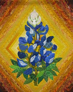 This quilt is by Barbara A. McCraw, a veritable artist. Bluebonnet flower...kick off those cowboy boots and cuddle up with this one. Or hang it on the wall...yeah, much better idea.