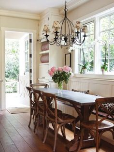 Long Table With Bench Seating TooCottage Dining Room Crown Molding Chandelier Wrought Iron Shades Custom Built In