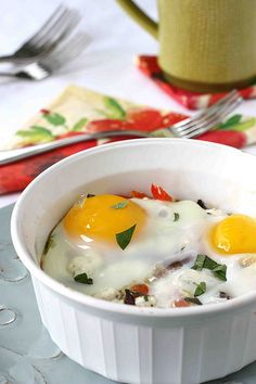 VEGETARIAN!  Greek baked eggs.  This has amazing flavor!  Hubby and I both liked it.  Only problem is that it took longer to cook than specified, therefore the yolks were not as runny as I would have liked.  Definately worth another go or two though lol.  Enjoy :-)