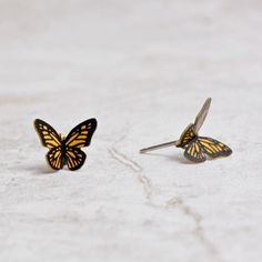 Remember when you first learned that a caterpillar becomes a butterfly? These sweet Monarch butterfly earrings will similarly transform your wardrobe! Pretty