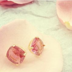 Oh so pretty pink studs and petals. I don't even like the color pink that much, but these are cute.