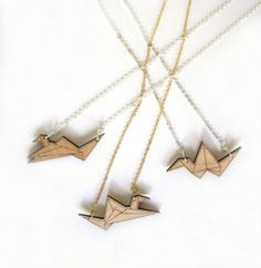 Reminds me of AlpAL.  Laser Cut Necklace  Origami Crane with Gold Chain by HavokDesigns