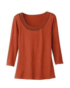 love the color, mesh trim and 3/4 sleeves of course...