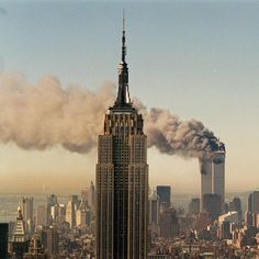 The view from uptown as the Twin Towers of the World Trade Center burn after the terrorist attacks.