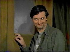 Alan Alda as the classic Hawkeye in MASH...