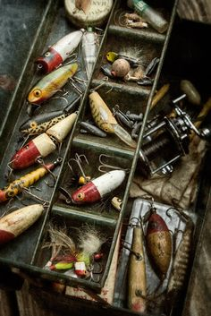 Old tackle box and bass fishing lures.