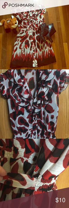 Red and Black Pattern Ruffle Button Down Dress Cute button down dress with ruffles around the neckline and a bold red and black latter.   Black slip is attached to dress .  Elastic waist with band that ties in back . Flattering cut .  I don't remember the brand on this because the dress had an itchy tag that I cut out .  It do remember that it is a size small .  I feel it runs a little big .  One of the straps of the skip is not connected to the dress but works fine . Shown is a slight tear…