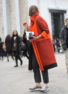 orange coat street style