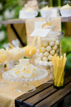 yellow and white dessert table