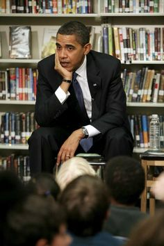 US President Barack Obama talk to children during their visit to the Capital City Public Charter School to meet with the 2nd Grade Class and read the book 'The Moon Over Star' at the school in Washington DC., USA, 03 February 2009.