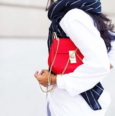 Walkinwonderland wearing a blue scarf with white pinstripes and a red bag with gold detail