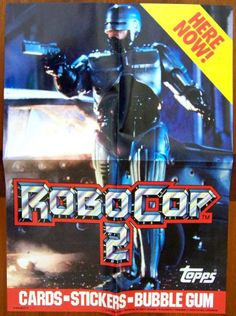 """1990 Topps Robocop 2 Trading Cards Promo Poster: Lot of 2, NM-, Quad Fold, opens to 10 x 14 inches, color shot of Robocop armed and ready to fire with a banner proclaiming """"Here Now!"""" Robocop 2 logo at the bottom with Topps and Orion Pictures copyrights. Both for $10"""