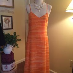 """Benetton Orange Maxi Dress  This is s beautiful lined maxi dress by United Colors of Bennetton. Size small. Orange color with an abstract squiggle of white running through it. Just gorgeous breezy!  Approx measurements are as follows. Bust: 16"""", waist 14"""", hips 19"""", length from bust 46"""". United Colors Of Benetton Dresses Maxi"""