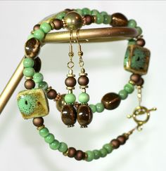 Green and Brown Raku Bead Necklace and Earrings. $30.00, via Etsy.