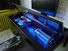 Use a desk instead of a computer case. With a glass top and some LED's and it will be looking good!