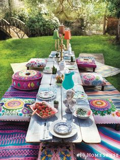 Create an al fresco paradise with footstools, outdoor rugs and whimsical table décor.