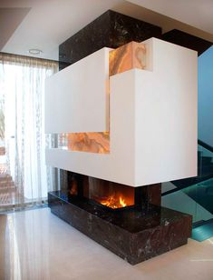 Contemporary Fireplace, The S House in Moscow by studio Fourth Dimension.