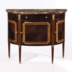 Wood cabinet with palissander veneer, rosewood trim, brown Emperador marble top,three locking curved doors, one drawer, one door, one shelf inside and antiqued brass hardware. Hand carved and hand fin