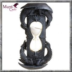 Gothic Dragon Hourglass Draconic Sands LARGE 35CM HIGH. This amazing and larger than average Gothic Dragons Hourglass has amazing detailing had two dragons entwined around the main pillar of the timer. It has further dragon decoration and the glass sand holder has pure white grains that contrast against the dark black slate colouring of this hand painted quality resin Timer. One of our favourite and a large one measuring 35cm high approx.