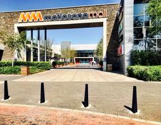 Ellipse bollards line the entrances to the Matlosana Mall :: in soot, both fixed and removable options :: RETAIL
