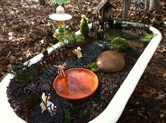 Our new woodland fairy garden... in an antique cast iron tub!