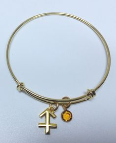 Sagittarius- Optimism, Philosophic, MotionGold plated adjustable bangle with gold plated sagittarius zodiac sign and swarovski november birthstone charms ($22) #sagittarius #november #birthstone #zodiac #gold #bangle #swarovski #pretty #ootd Available @ http://shareindipity-com.myshopify.com/collections/zodiac-collection/products/copy-of-gold-bangle-peace-charm