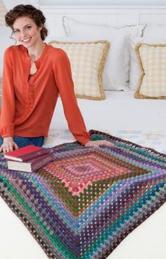 You'll love the way colors of this yarn work together for a very special throw. It is crocheted in the round starting at the center. It's just like making a very large granny square!