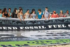 Hundreds gathered on Copacabana beach in Rio de Janeiro to demand an end to fossil fuel subsidies. #RioPlus20